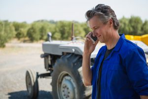 Worker talking on mobile phone on a sunny day